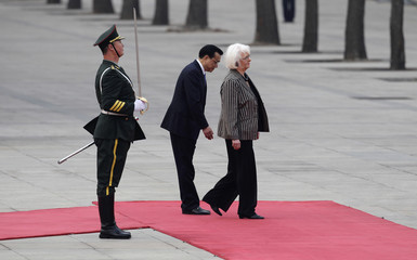 Iceland's Prime Minister Sigurdardottir prepares to inspect the guard of honour with China's Premier Li in Beijing