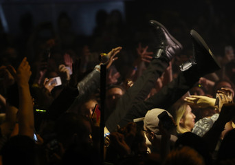Hip hop artist Desiigner jumps onto members of the audience during the iHeartRadio Much Music Video Awards (MMVAs) in Toronto