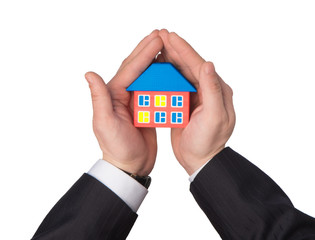 House in hand as a symbol of insurance