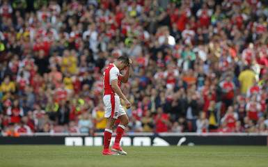 Arsenal's Alexis Sanchez walks off to be substituted