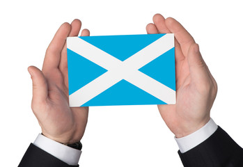 Flag of Scotland in the hands