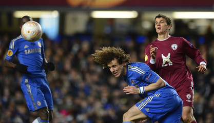 Chelsea's David Luiz challenges Rubin Kazan's Roman Eremenko during their Europa League first leg quarter-final soccer match at Stamford Bridge in London