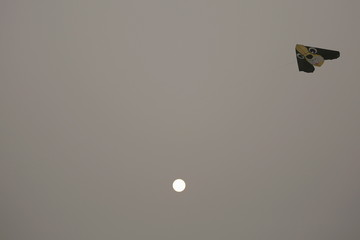 The sun is seen behind a kite flown on an extremely polluted day in Baoding