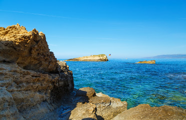Rocks on the coast of Cretan Sea near Hersonissos, Crete, Greece.