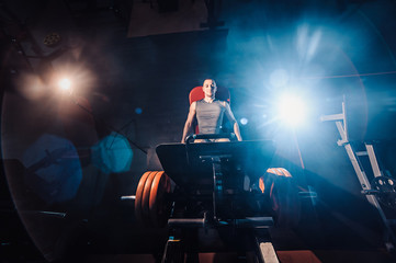 Man Using A Press Machine In A Fitness Club