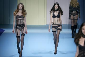 Models present creations during the Etam Live Show Lingerie at Piscine Molitor during Paris Fashion Week