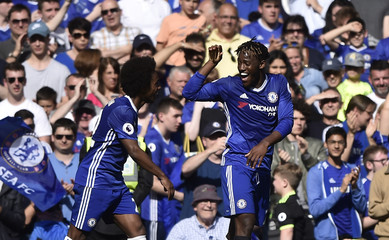 Chelsea's Michy Batshuayi celebrates scoring their fourth goal with Willian