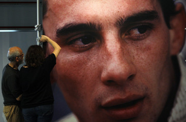 Architects set up a picture of Brazilian Formula One driver Ayrton Senna for an exhibition at the Imola race track