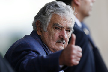 Uruguay's President Jose Mujica waves as he leaves the Itamaraty Palce after the 6th BRICS summit and the Union of South American Nations (UNASUR) in Brasilia
