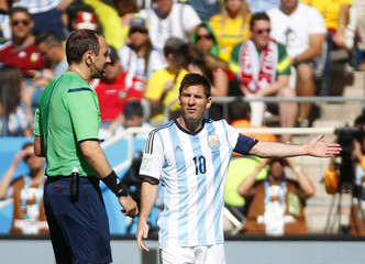 Argentina's Messi argues with referee Eriksson during the 2014 World Cup round of 16 game between Argentina and Switzerland in Sao Paulo