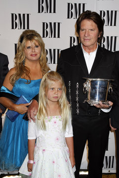 John Fogerty poses with his wife Julie and daughter Kelsy as he arrives at the 58th annual BMI Pop Awards in Beverly Hills