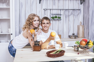 Man and woman young and beautiful couple in the kitchen home cook and have Breakfast together