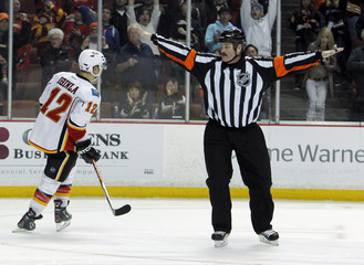 Referee St. Laurent signals no goal on an overtime shootout shot by Calgary Flames right wing Iginlaagainst Anaheim Ducks in their NHL hockey game in Anaheim