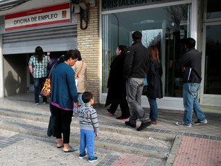 People enter a government-run job centre in Madrid