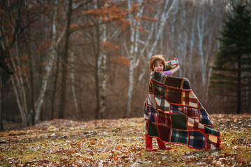 Girl wrapped in a blanket spinning around