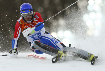 France's Grange clears a pole as he competes in the first run of the men's alpine skiing slalom event during the 2014 Sochi Winter Olympics at the Rosa Khutor Alpine Center