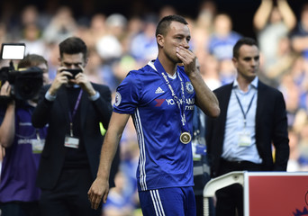 Chelsea's John Terry celebrates with his winners medal after winning the Premier League