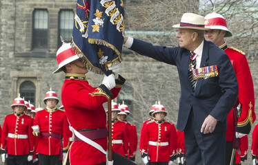 His Royal Highness Prince Philip, Duke of Edinburgh entrusts new regimental colours to Lieutenant Bronson Peacock from 3rd Battalion of The Royal Canadian Regiment in Toronto.