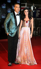 Singers Robbie Williams and Jenifer arrive to attend the NRJ Music Awards ceremony at the Festival Palace in Cannes