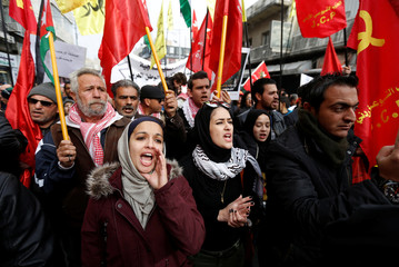 Jordanian protesters chant slogans during a rally to support security services after shooting at Karak castle in Amman