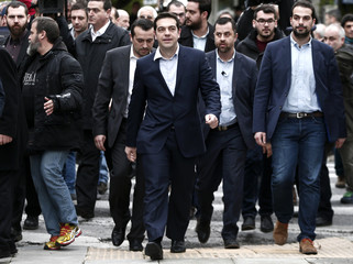 Newly appointed Greek PM and winner of the Greek parliamentary elections, Alexis Tsipras, arrives for a swearing in ceremony by members of his cabinet at the presidential palace in Athens