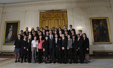 U.S. President Barack Obama pose for a picture with student finalists of the Intel Science Talent Search 2011 competition in the East Room at the White House