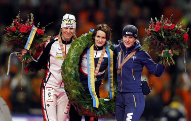 Czech Republic's Sablikova, Canada's Groves and Netherlands' Wust pose at World Speed Skating Championships in Heerenveen