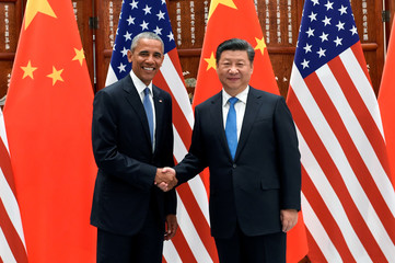 Chinese President Xi Jinping and U.S. President Barack Obama shake hands during their meeting at the West Lake State Guest House in Hangzhou, China