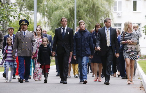 Astronauts attend a farewell ceremony on their departure to Baikonur in Star City