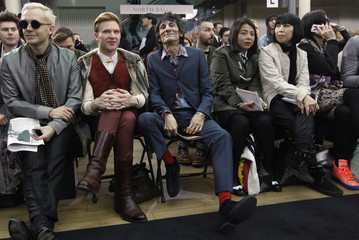 Rolling Stones guitarist Wood sits in the front row before the presentation of the Topman Design 2012 Autumn/Winter collection during London Fashion Week
