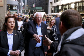 U.S. Democratic presidential candidate Bernie Sanders greets supporters as he arrives at a hotel in New York