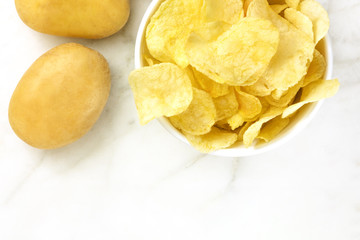 Chips with potatoes, shot from above with copyspace