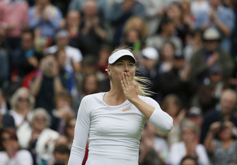 Maria Sharapova of Russia reacts after defeating Kristina Mladenovic of France in their women's singles tennis match at the Wimbledon Tennis Championships, in London
