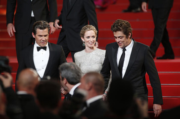 """Cast members Josh Brolin, Emily Blunt and Benicio Del Toro pose on the red carpet as they leave after the screening of the film """"Sicario"""" in competition at the 68th Cannes Film Festival in Cannes"""