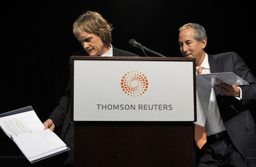 Thomson Reuters Chairman Thomson steps down from the podium as CEO Glocer gets up to speak at their Annual Meeting of Shareholders in Toronto