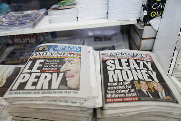 Stories regarding the arrest of IMF head Strauss-Kahn are seen on the front pages of the New York Daily News and the New York Post in New York
