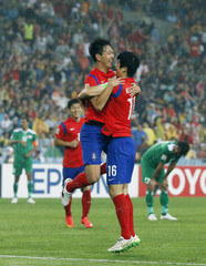 South Korea's Kim Young-gwon celebrates with teammate Ki Sung-yueng after scoring a goal against Iraq during their Asian Cup semi-final soccer match at the Stadium Australia in Sydney