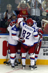 Russia's players celebrate the goal of team mate Shirokov against Germany during the third period of their men's ice hockey World Championship Group B game at Minsk Arena in Minsk