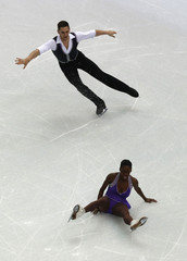 France's James and Cipres during the figure skating team pairs' short program at the Sochi 2014 Winter Olympics