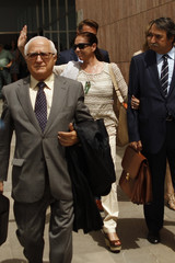 Spanish singer Pantoja waves as she leaves a court after her trial