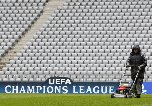 A worker mows the lawn in Munich's Allianz Arena