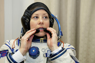 U.S. astronaut Tracy Caldwell Dyson takes part in an examination at the Star City space centre outside Moscow