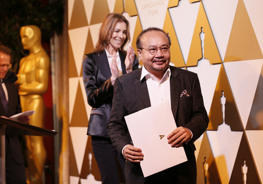 Director Panh accepts his nomination certificate from presenter director Kathryn Bigelow (rear L), at the 86th Academy Awards Foreign Language Nominee Reception at Ray's and Stark Bar on the LACMA Campus in Los Angeles