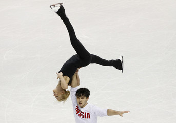 Volosozhar and Trankov of Russia skate during pairs practice sessions at the ISU World Figure Skating Championships in London