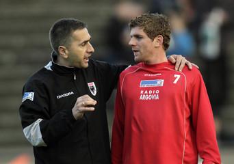 FC Aarau's interim coach Jakovljevic talks to Marazzi as they warm up before their Super League soccer match against Neuchatel Xamax in Aarau