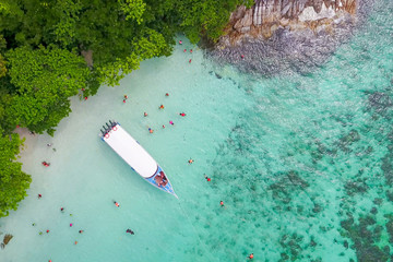 Aerial view over speed boat with beautiful sea and beach,Top view from drone, Koh Lipe island, Satun,Thailand