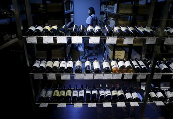 An employee works at a wine outlet in Seoul