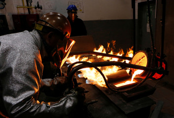 Employee works at Krastsvetmet non-ferrous metals plant in Krasnoyarsk
