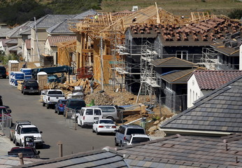 Residential homes are shown under construction in a new subdivision in San Marco, California