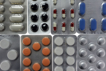 Pharmaceutical tablets and capsules in blister packs are arranged on table in illustration picture in Ljubljana